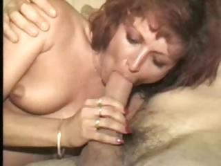 Interracial four-way between a yummy redhead and three dongs